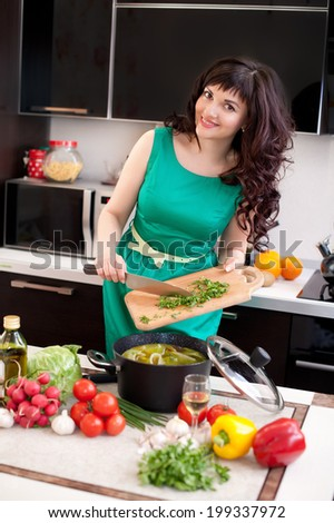 beautiful girl preparing food on  kitchen - stock photo