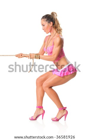 Beautiful girl pulling a rope isolated on white background - stock photo
