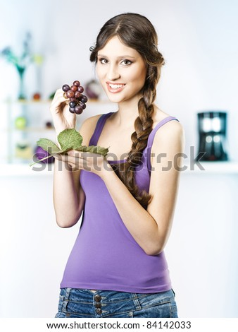 beautiful girl reading newspaper in the kitchen - stock photo