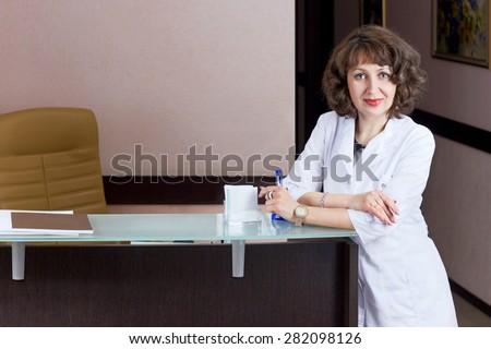 beautiful girl reception desk receptionist professional work - stock photo