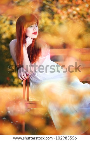 Beautiful girl relaxing in a magic garden