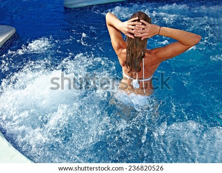 Beautiful girl relaxing in jacuzzi. Spa background - stock photo