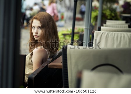 beautiful girl relaxing in the street near cafes - stock photo