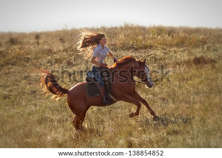 Beautiful girl riding a horse  in countryside.