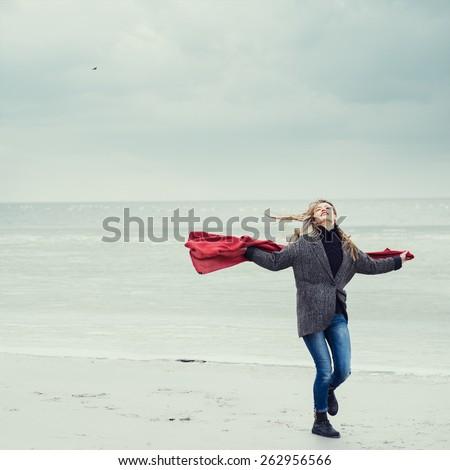 beautiful girl runs along the beach - stock photo