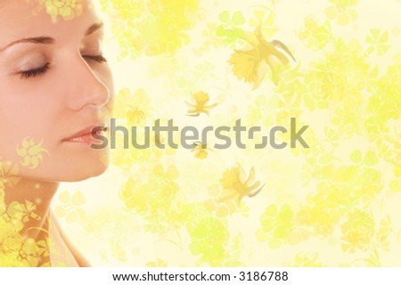 Beautiful girl's face on abstract floral background - stock photo