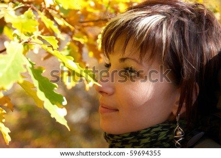 Beautiful girl's portrait with soft autumn background - stock photo