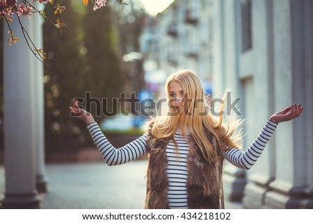 Beautiful girl scatters hair - stock photo