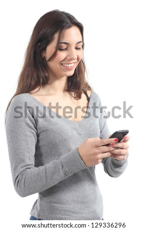 Beautiful girl sending a message with a mobile phone in a white isolated background - stock photo