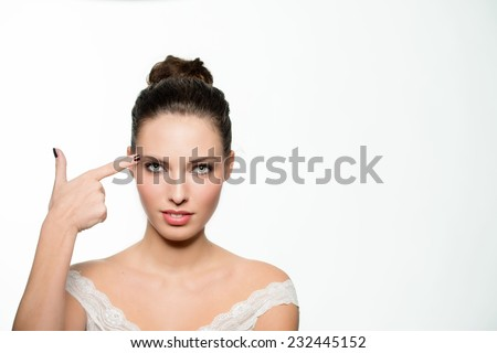 Beautiful girl shooting at her head with hand gun. Failure concept abstract. Isolated against white. - stock photo