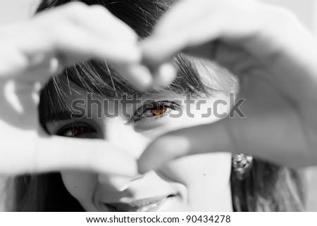 Beautiful girl show love sign - stock photo