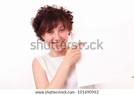 Beautiful girl shows a blank sheet of paper - stock photo