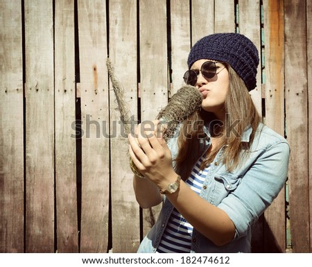 beautiful girl singer with glasses singing outdoor, instagram effect