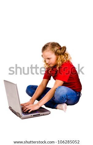 Beautiful girl sitting at the computer playing over white background
