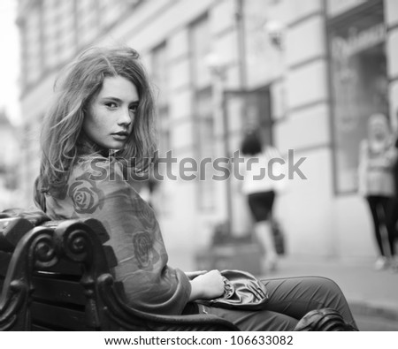 beautiful girl sitting in a rest - stock photo