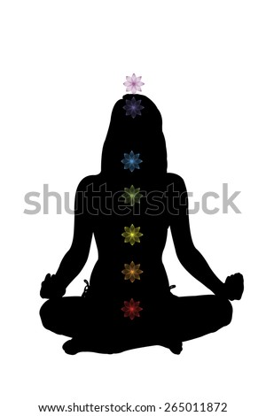 Beautiful girl sitting in lotus position with chackra illustration. Enlightenment, practice, yoga and consciousness. - stock photo