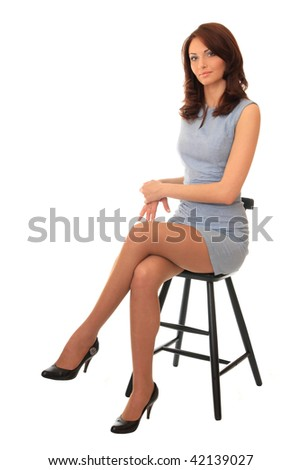 Beautiful girl sitting on a bar chair. - stock photo