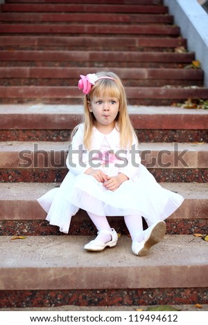 Beautiful girl sitting on the stair