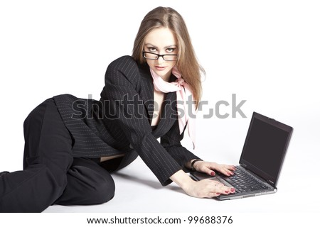 Beautiful girl sitting with a laptop isolated on white background - stock photo