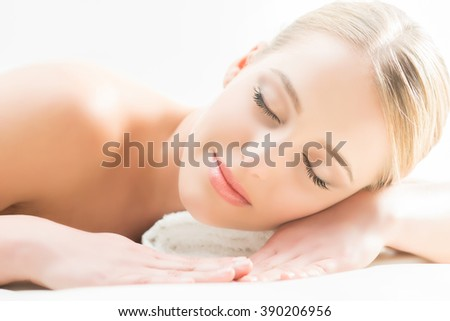 Beautiful girl sleeping and have a spa treatment isolated on white. - stock photo