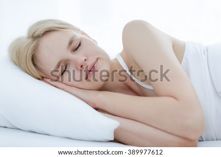 Beautiful girl sleeping in bed. - stock photo