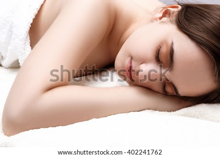beautiful girl sleeps in the bedroom. Relaxation. Girl lying with his eyes closed.
