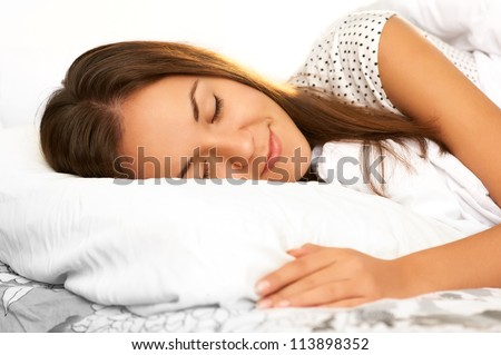 beautiful girl sleeps in the white bedroom - stock photo