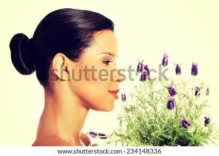 Beautiful girl smell purple lavender flowers - stock photo
