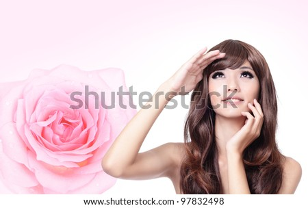 Beautiful Girl smile face close up with pink rose background,model look up forward, model is a asian beauty - stock photo