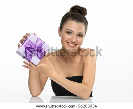 Beautiful girl smiling and hold gift on white background.