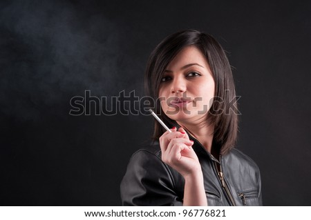 Beautiful girl smokes - stock photo