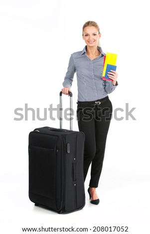 beautiful girl standing with black luggage. young girl holding tickets on white background? - stock photo