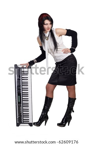 Beautiful girl staying with synthesizer isolated. More images of this models you can find in my portfolio - stock photo