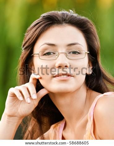 Beautiful girl-student against autumn nature. - stock photo