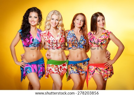 Beautiful girl summer dress beach fashion, woman  bikini models in colorful costume, fashion for fitness and belly dance, clothes for training, series, studio, isolated. - stock photo
