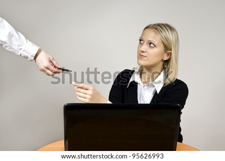 beautiful girl takes the flash drive while sitting at the laptop - stock photo