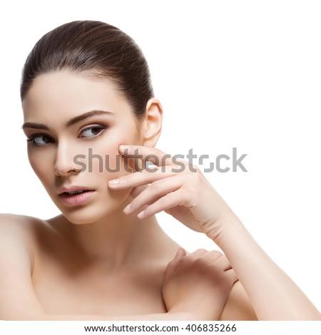Beautiful girl touching face - stock photo