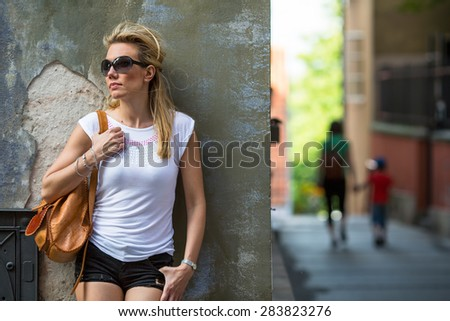 Beautiful girl tourist in the abstract old town. Woman portrait in Old Europe. - stock photo