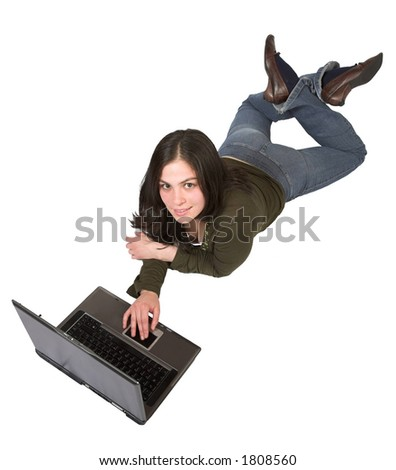 beautiful girl using a laptop on the floor over a white background
