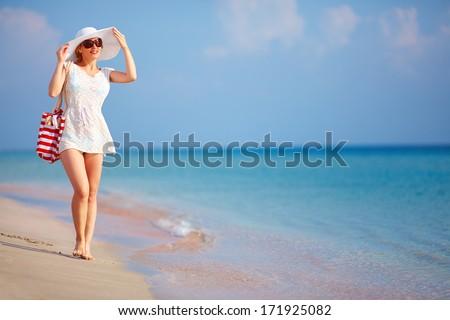 beautiful girl walking the summer beach - stock photo