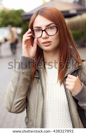 Beautiful girl walks down the street of European city