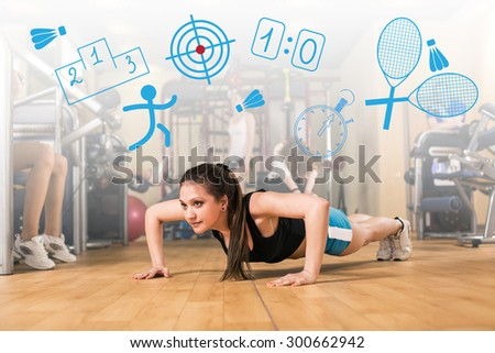 Beautiful girl warming up and doing some push ups a the gym