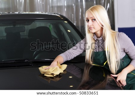 beautiful girl wash cars - stock photo