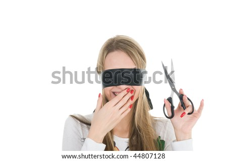 Beautiful girl wearing black band on his eyes and holding scissors - stock photo