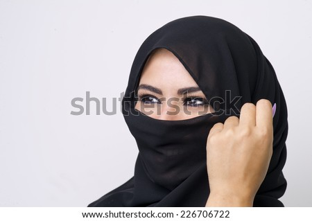 Beautiful girl wearing burqa closeup  - stock photo