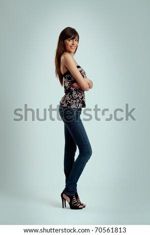 girl posing in skinny jeans