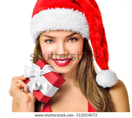 Beautiful  girl wearing santa claus clothes. Christmas Woman. Beauty Model Girl in Santa Hat isolated on White Background.