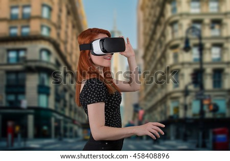 beautiful girl wearing virtual reality goggles, day city