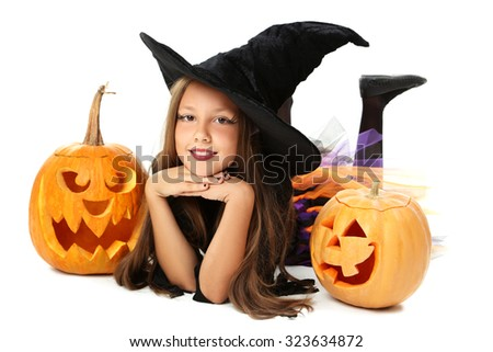 Beautiful girl witch with pumpkin on a white background