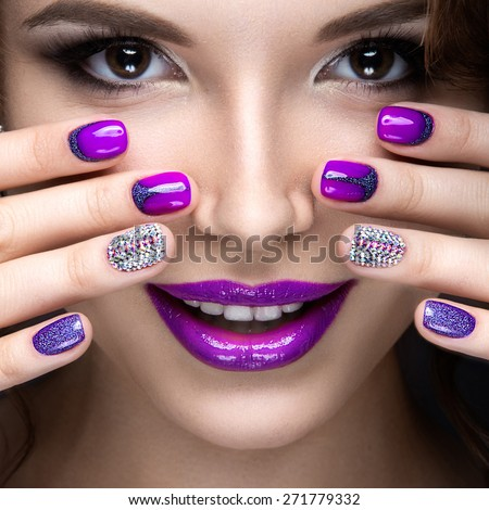 Beautiful girl with a bright evening make-up and purple manicure with <b>...</b> - stock-photo-beautiful-girl-with-a-bright-evening-make-up-and-purple-manicure-with-rhinestones-nail-design-271779332